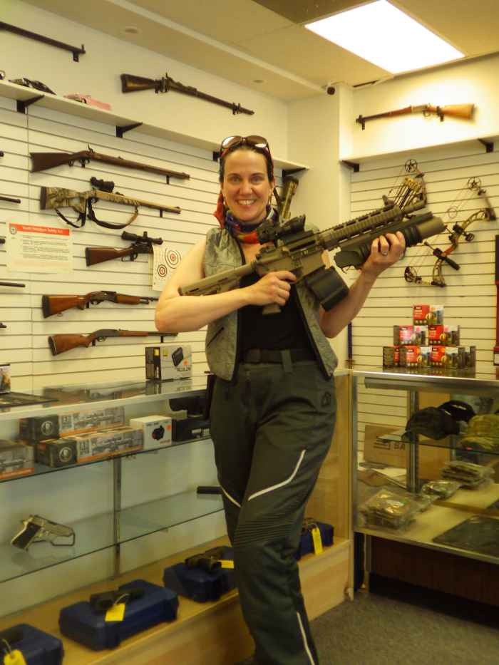 NMBL holding an assault rifle at Sector Gun Shop in Spanish Fork.